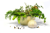 herbs and spices bunch in a bowl with a pestle