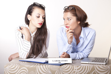 Two young beautiful female receptionists