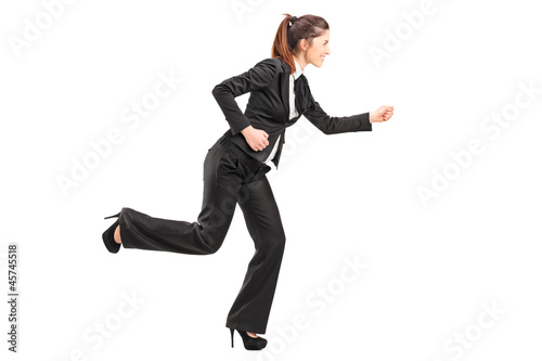 Full length portrait of a businesswoman in hurry running
