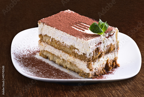 Delicious tiramisu cake on a plate - isolated
