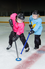 Ringette Players in Action at Hockey Rink