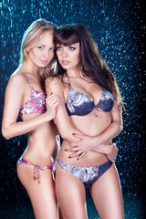 Brunette and Blond in a bikini in the rain
