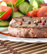 Closeup of grilled beef steak with fresh vegetables