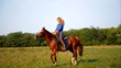 Young blonde girl riding a horse