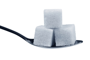 Spoon with sugar cubes