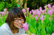 Cute Thai girl scent a pink Siam Tulip