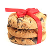 Chocolate chips cookies with red ribbon isolated on white.