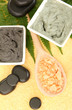 cosmetic clay for spa treatments on yellow background close-up