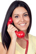 Attractive brunette girl calling with red phone