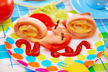 snails made from sausage and cheese for child
