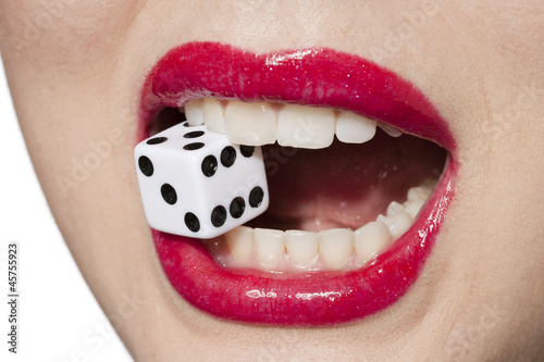 woman biting dice