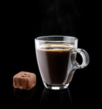 cup of coffee with a chocolate bonbon