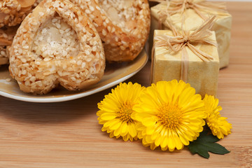 cookies on the plate with yellow flowers and gifts