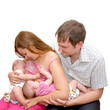 Breast feeding two little sisters twins Isolated on white