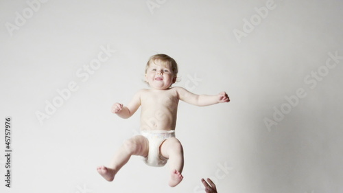 Father Playfully Throws His Baby Daughter  in the Air,