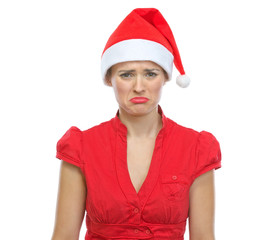 Portrait of sad young woman in Santa hat