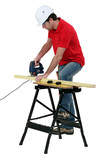 Worker sawing