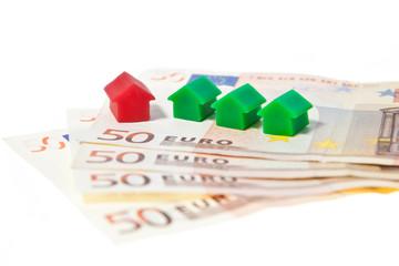 Häuser mit Banknoten