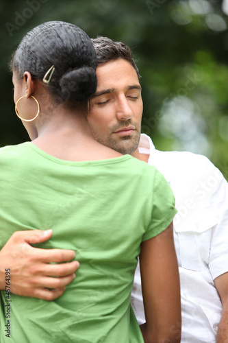 a man comforting his wife