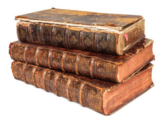 Three seventeenth century antique books isolated on white