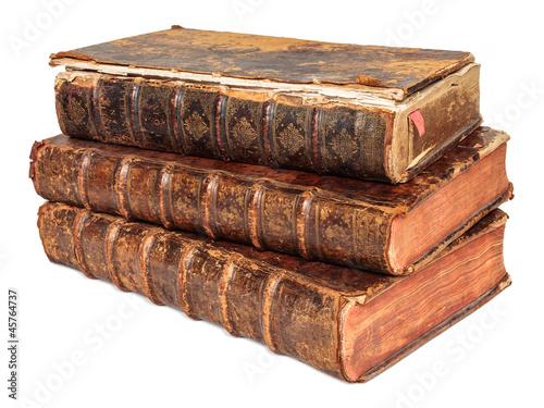 Three seventeenth century antique books isolated on white