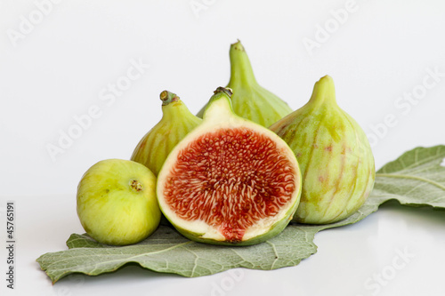 Green figs on fig leaf