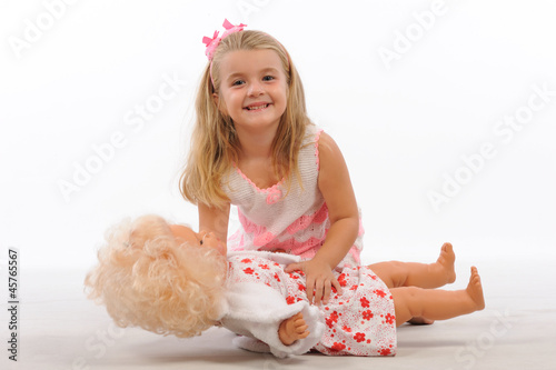 Sweety girl playing with doll isolated white background