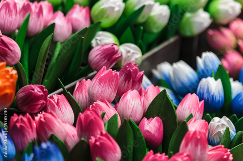 Colorful wooden souvenir tulips for sale at a market