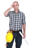 Engineer scratching his bald head
