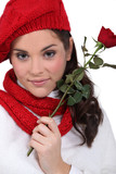 girl with red rose and assorted clothing