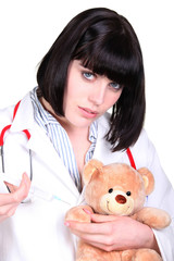 Doctor administering an injection to a teddy bear