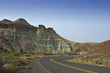 Colorful Cathedral Rock and leading highway in eastern Oregon