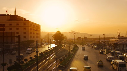 View to the Eminonu port and Ragip Gumuspala street at sunset in