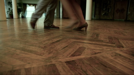 Couples feet doing steps during dance