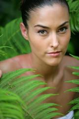 Woman in green foliage