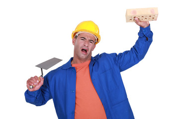 workman with trowel and sponge playing the fool
