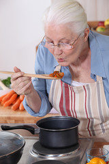 A grandmother cooking.