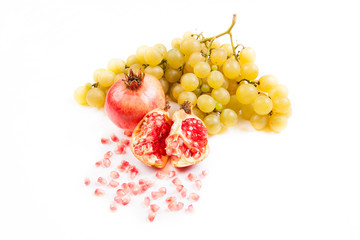 Juicy pomegranate with white grapes fruit