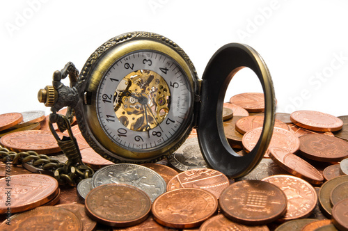 Pocket Watch On Pile Of Coins