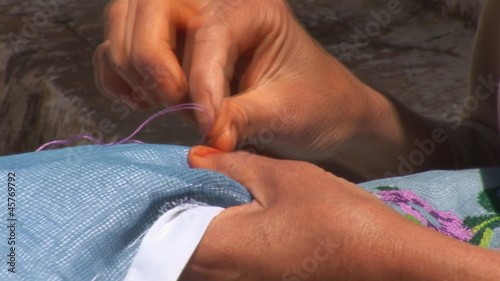 Woman embroidering needle pattern