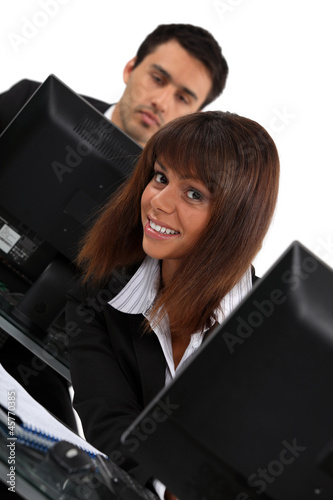 Woman peeking out from behind her computer