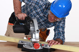Tradesman using a mitre saw