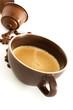 Tazza di caffè con chicchi e capsule