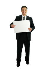 Innovative businessman pointing to a blank sign