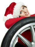 Miss santa leans against a winter tire waiting  for christmas