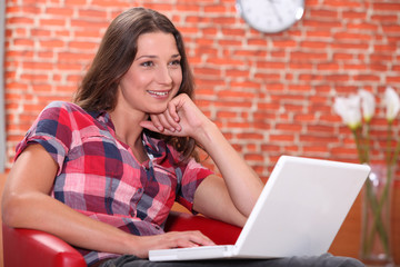 Relaxed woman using her laptop