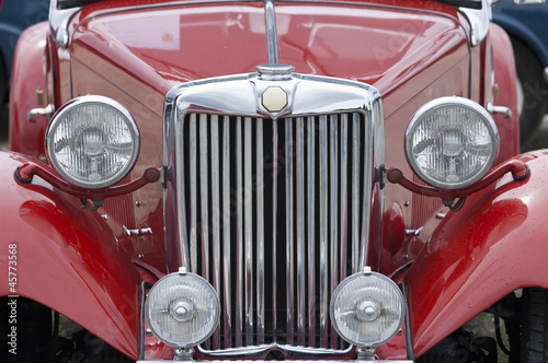 Front of old red car, closeup