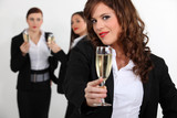 Three young business women toasting success