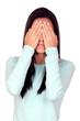 Attractive brunette girl covering her eyes
