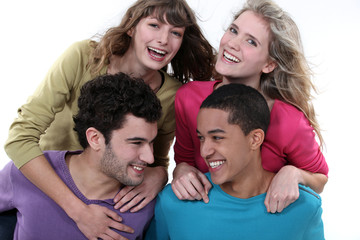 elated young foursome of students